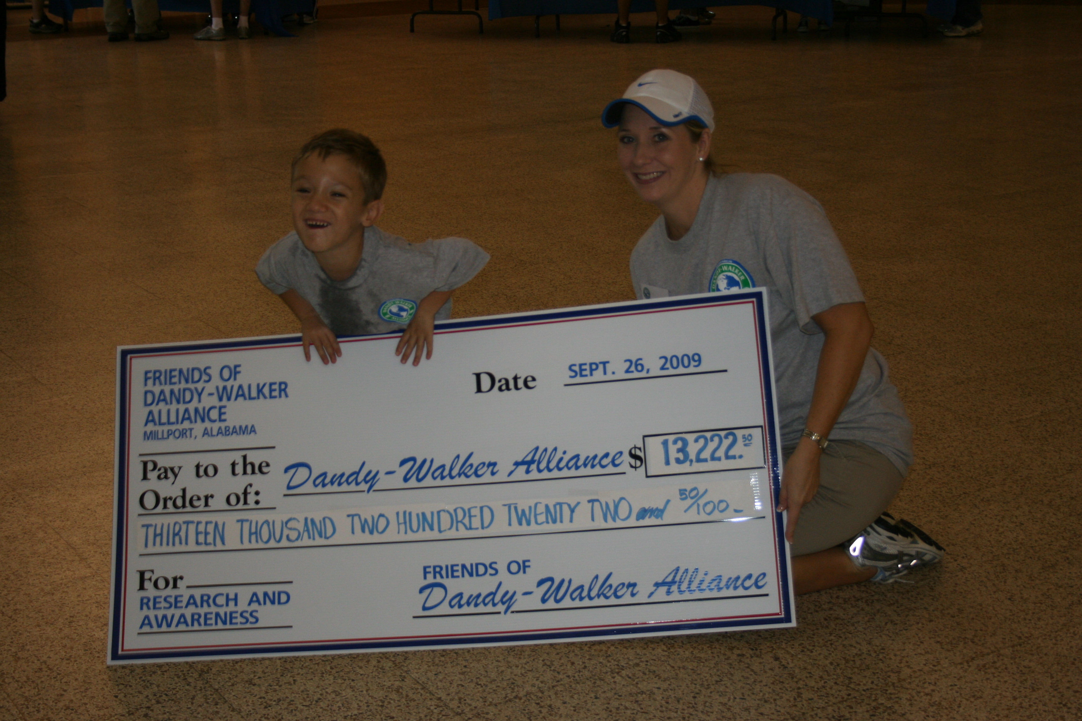 "Ryan and Emily with ""The Big Check"""